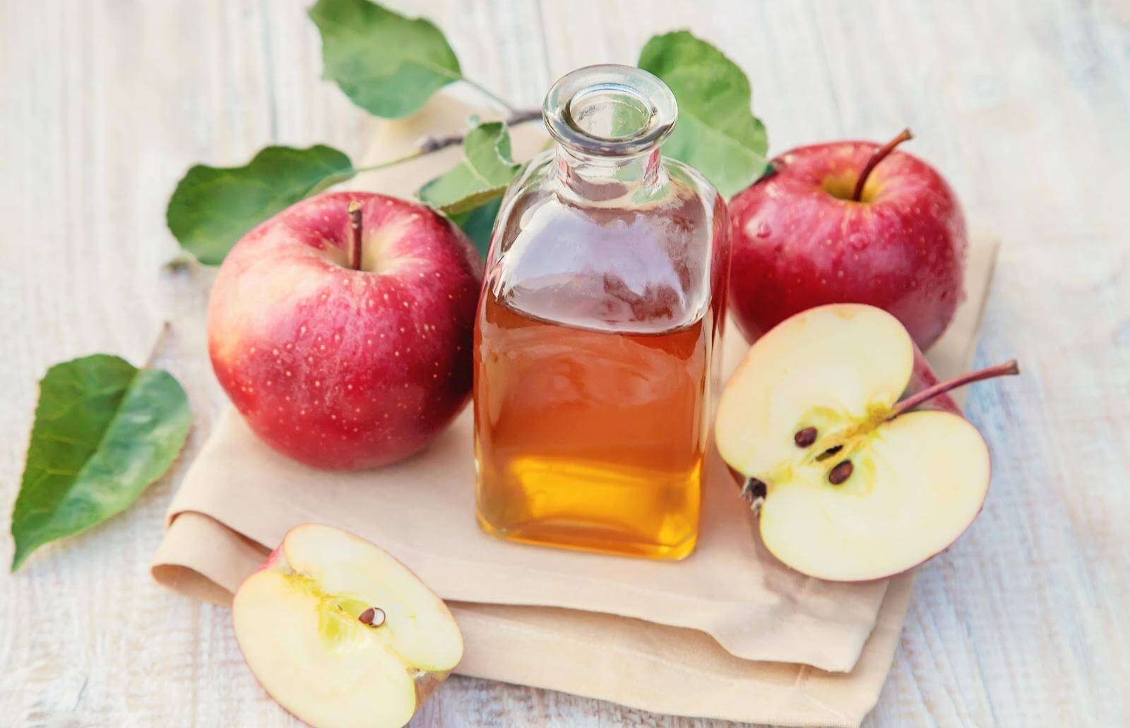 Vinegar, has a low pH; meaning it is acidic.  Apple cider vinegar is also an acidic vinegar.  The acetic acid in vinegar helps cure Candida problems.