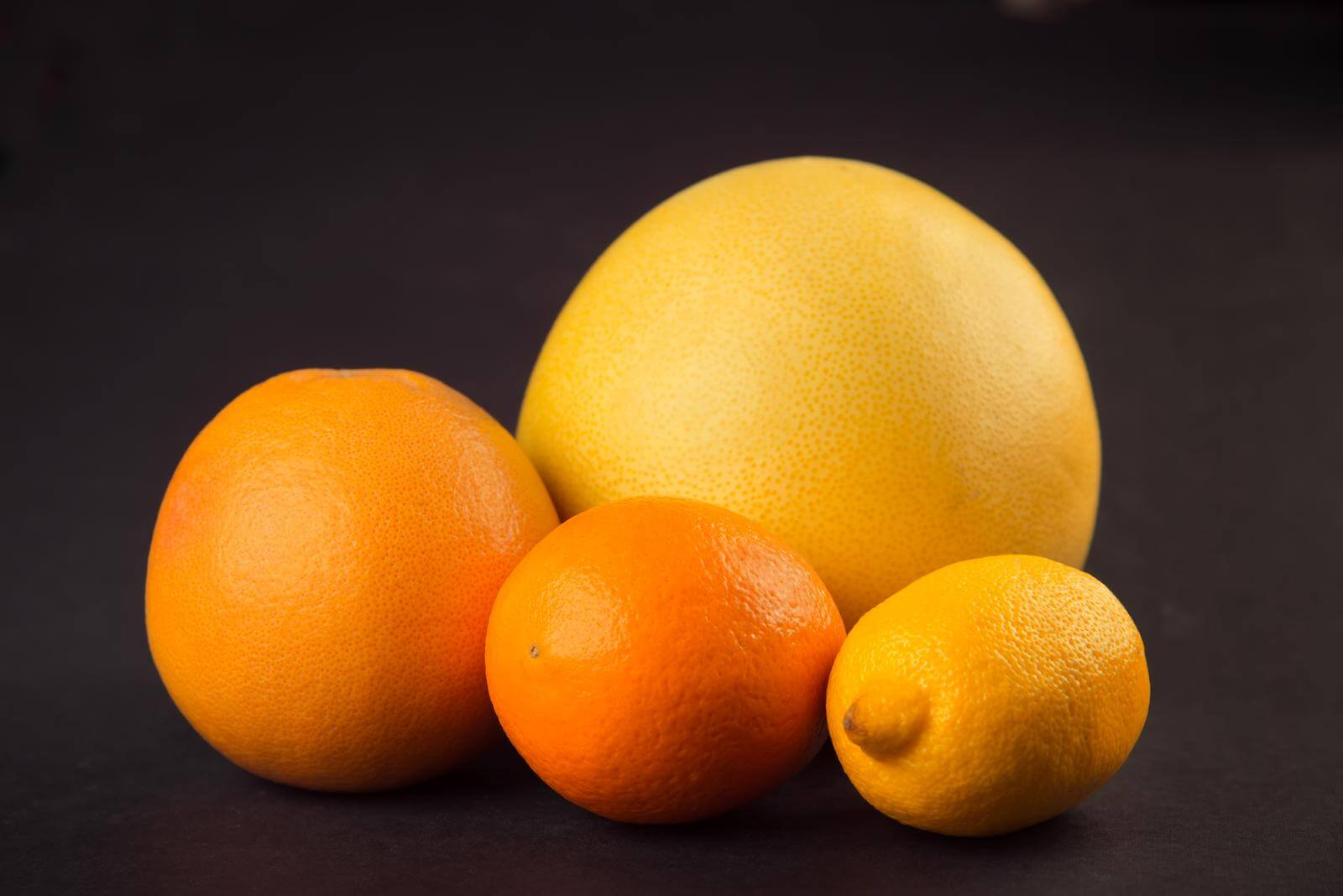 Citrus fruits are rich in citric acid; this same acid can be employed in pH balancing tampons. Some species of Lactobacillus bacteria secrete lactic acid; which also may be used in pH balancing feminine products. Keeping vaginal pH at a healthy, acidic level is important for allaying yeast infections.